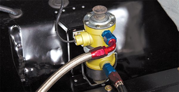 In the R-Model's trunk, on the side opposite the battery, was a Stewart-Warner 240A electric fuel pump that worked in conjunction with the engine's mechanical pump.
