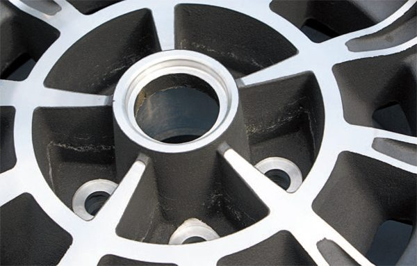 Original production 10-spokes were bare aluminum but an early prototype set or two were blacked-out between the spokes. In later years, Carroll Shelby's wheel company reproduced the 10-spokes in both a bare or blacked-out finish.