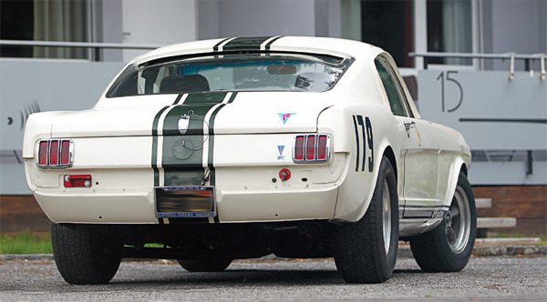 """While Guardsman Blue LeMans stripes were optional on the street GT350, all R-Models except one got them. Instead of blue LeMans stripes, 5R096 left Shelby American adorned with the dark green top stripe of Canada's Comstock Racing Team. One of its Comstock stable mates was an almost identical white Mustang fastback equipped with many Shelby R-Model """"go-fast"""" features. (Photo Courtesy Claude Nahum)"""