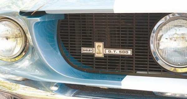 Either the grille badge was also used on the dash and on the deck lid; or the dash badge was also used in the grille or on the deck lid; or the deck lid badge was also used in the grille and on the dash. Regardless of the semantics, the three badges were identical and were newly designed for the 1967 Shelby. Like the snake fender-badges, two versions were made, one for small-block GT350s and one for big-block GT500s; only the lettering of the car's designation was different. The 1967 Shelby was the only year that placed the grille badge on the passenger's side.