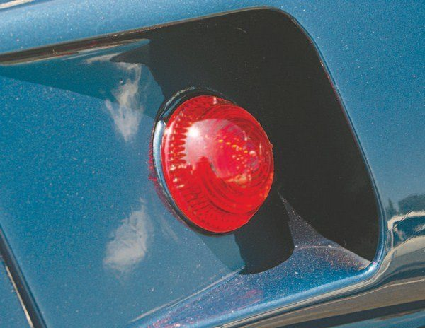 The marker lights in the rear of the early air extractor scoops were sourced from the truck/tractor-trailer industry. The lights were tied into the car's taillight wiring harness in the trunk