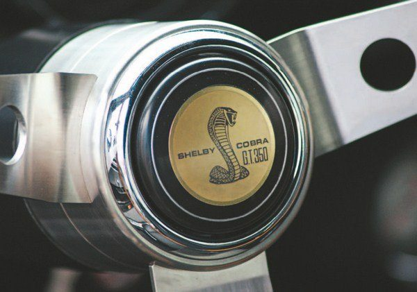 Shelby American wanted a horn button in the center of the real wood steering wheel for the 1967 Shelby instead of the toggle switch as on the dash of the 1965 cars, and it got it. As elsewhere on the car, the steering wheel center cap carried badging specific to either the GT350 or GT500.