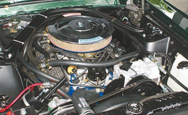The engine compartment of a 1967 GT350 filled up fast with the addition of air conditioning and Thermactor emissions which necessitated that the ignition coil be relocated to the very toasty location of above the intake and under the carburetor.