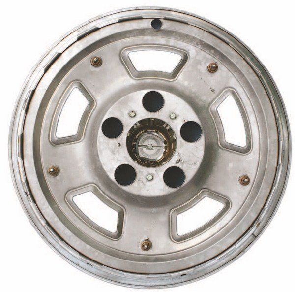 The Thunderbird lineage of the 1967 Shelby wheel cover is plainly visible in the back of the molded centercap. Holes allowed real chrome lug nuts to show through to the front of the wheel cover, giving the appearance of an actual mag-type wheel.