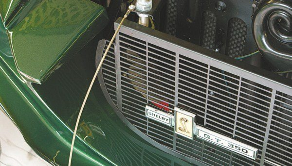 Later cars featured a true two-piece grille installation with two separate and distinct pieces of mesh. The upper grille mesh fit within the upper opening in the fiberglass and was mounted vertically. The lower grille, like in the early slanted installation, was mounted behind the lower grille opening.
