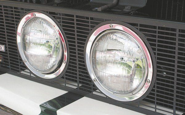 The two center-mounted headlights don't protrude from the vertical upper grille mesh used on later cars as much as from the early angled grille mesh. On cars with two-piece grilles, both the inner and outer headlight trim rings were chrome.