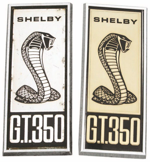 Graphically, the very early flat and the later raised fender badges were almost identical, the only difference being in the relief of the later piece(right). Most 1967 Shelbys got the raised fender badge.