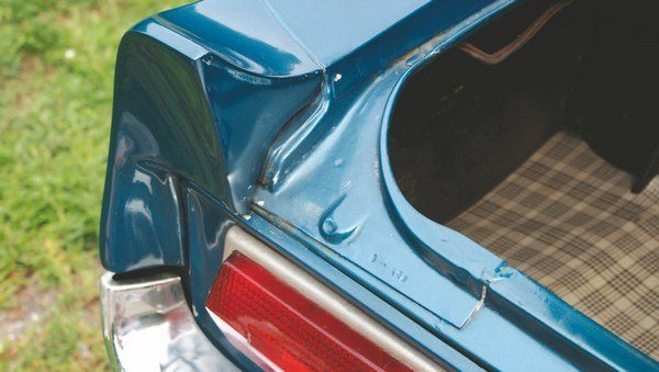 The tail panels went through an iterative process with at least three variations being used on the 1967 Shelby. The earliest types mounted to the rear face of the Mustang and were secured with four studs protruding into the interior of the trunk. These were the most prone to water leakage and required the most warranty work to preclude the trunk from turning into a swimming pool. The solution was to pack handfuls of sealing dumdum into and around the taillight boxes.
