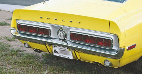 The rear end of the GT500 KR was basically identical to earlier GT500s and GT350 cars except for a couple of subtle styling cues. All KRs were built on Mustangs that themselves were built after the changeover of the rear-marker lights, so a GT500 KR with early squared-off marker lights needs some explanation. Only 144 cars were painted WT 6066 Yellow, which replaced the hard-to-match Sunlit Gold.
