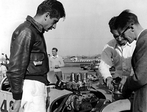 Barney, seen here at Los Angeles' Carrell Speedway with Tom Beatty and George Pounden (right), was one of the first, if not the first, to bolt a GMC blower atop a flathead. Four Stromberg 97s fed the quad-belt-driven 3-71. (Photo Courtesy H&H Flatheads)