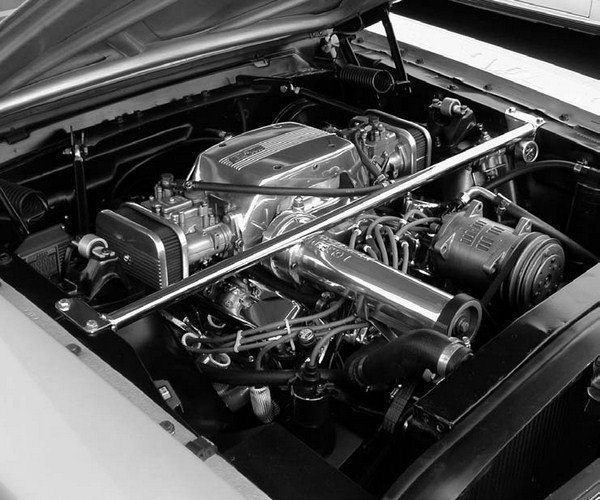 High RPM, small-displacement superchargers made a comeback in the late 1970s and early '80s. Shown here is a B&M Performance Products street blower, mounted on Herb McManken's highly modified early-model Mustang convertible. Note that this application uses a pair of Mikuni side-draft carburetors.