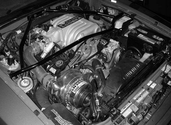 Were it not for the introduction of the 5.0L (302ci) engine Fox Platform Mustang in 1979, Paxton Products may have languished indefinitely. In 1985, the Santa Monica, California, blower house released its SN-60-based street supercharger kit for the Mustang V-8 models. It was basically a redesign of the old carbureted Shelby GT 350 kit. With the 1986 introduction of the 5.0L engine Sequential Electronic Fuel Injection (SEFI) Mustangs, Paxton literally blew the lid off the market with the release of its 50- state-legal street supercharger kit. Paxton refined this application over the years with the release of the SN-92, SN-93, and SN-2000 5.0L-based street supercharger packages. Shown is the final SN-2000 incarnation installed on Craig Conley's first-generation 1993 SVT Mustang Cobra.