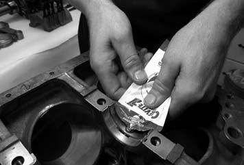 2. With Clevite engine bearings already installed, liberal amounts of engine assembly lube is applied to the main bearings.