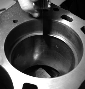 5. Next, the Childs & Albert file-to-fit top ring gap is checked and a measurement of 0.020 to 0.025 inch is achieved.