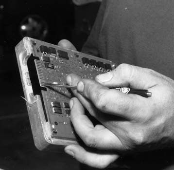 20. We covered installing the special Paxton OBD II legal chip in the body copy of our text. Here we see our man doing the deed.