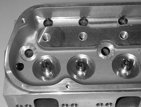 These heads also utilize 3⁄8- inch screw-in rocker arm studs using a set of ARP's 134-7104 rocker arm studs, which come with their own pushrod guide plates.