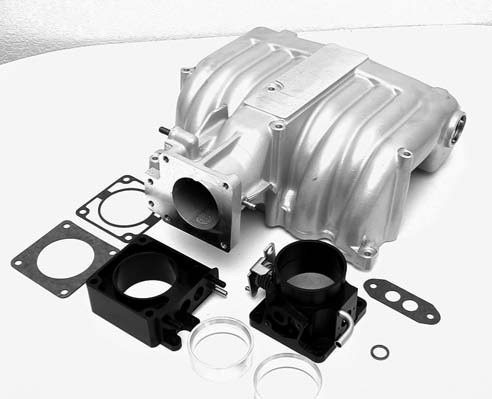Bolted to the top is an FRT Cobra M-9424-D52 cast-aluminum intake plenum, which ingests huge amounts of oxygen through a Ground Pounder Performance Products adjustable venture 65- to 75-mm billet-aluminum throttle body, which comes black anodized.