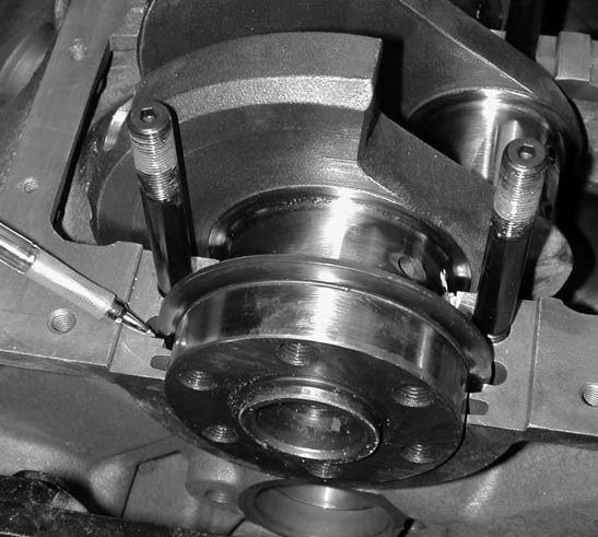 6. Our first problem area proves to be the rear lip on the crank. It rubs against the oil slinger lip recess area on the block. About 0.060 inch is machined off this area and everything is okay.