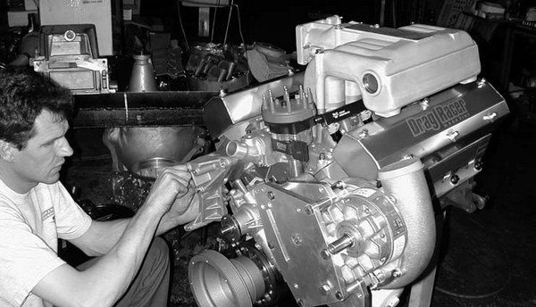 46. The alternator bracket is installed using two 3⁄8 x 51⁄2-inch bolts and one 7⁄16 x 51⁄2-inch bolt. We've taken our 408 as far as we can take it – until it goes to the dyno shop!