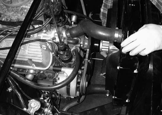 2. Next, the alternator is removed. The fan belt and fan are removed in order to install the Paradise Paxton 8-rib serpentine belt crank pulley onto the existing v-belt-drive pulley setup.