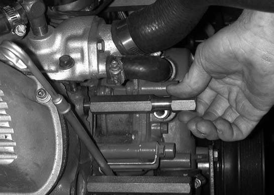 7. Prior to going any further, it may be necessary to trim approximately 1 inch of material off the heater hose nipple on the water pump. This is done to clear the inner stud and to provide enough clearance for the rubber hose. Don't worry; there is still enough material left.