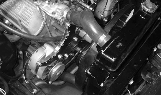 10. Our alternator is remounted in position at the underside of the supercharger mounting bracket.