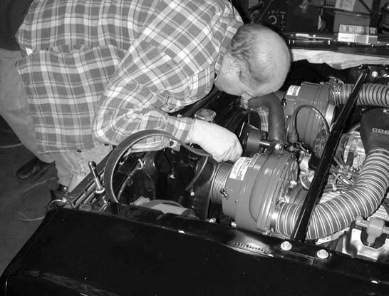 17. Rear air bonnet and air intake hose installation, reinstallation of the fan and accessory drive fan belt, and installation of the 8-rib serpentine blower drive belt come next.