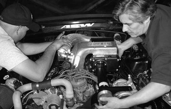 10. Now it's time to install the 2.2L Kenne Bell Blowzilla twinscrew supercharger onto the GT40 lower intake. As you can see, this is a two-man job.