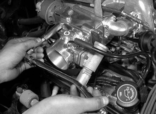 15. Using the provided factory bolts, the Accufab 70-mm throttle body and accompanying linkage is installed.