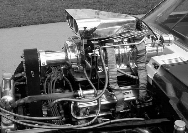 """Other approaches to street supercharger induction systems include the use of a conventional """"bug catcher,"""" or a two- or four-hole fuel injector housing like those used on the old gasers or dragsters, along with a dry supercharger and digitally controlled electronic fuel injection."""