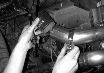 34. The intercooler exit pipe (which runs up to the throttle body) is installed using the provided stainless-steel band clamps, and is joined to a 21⁄2-inch silicone hose at the other end.