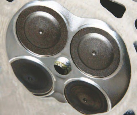 This 2011–2014 CNC-machined 57-cc Coyote combustion chamber offers the best characteristics ever in a Ford chamber. The spark plugs are centered right in the middle of the action amid two 1.460-inch/37.0-mm intake and two 1.220-inch/31.0-mm exhaust valves.
