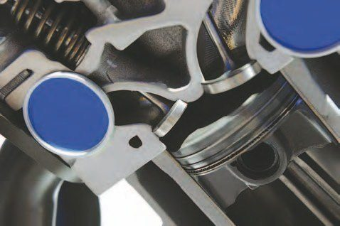 This close-up of the BOSS 302 head port configuration conveys what makes this head better: Better aluminum. As well as CNC port work going in and coming out. (Photo Courtesy Ford Performance Parts)
