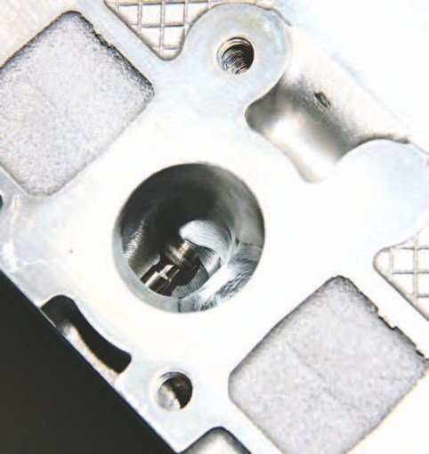 Exhaust ports on the TEA Coyote CNC-ported head are hand worked after all CNC machining has ended. The result is thorough scavenging.