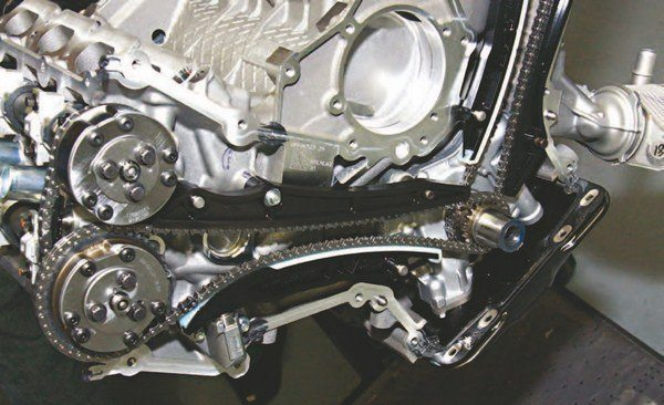What makes the Coyote different is the VCT sprockets/phasers that index the cams based on PCM input and oil pressure modulation at the phasers. As with the 4.6L and 5.4L engines there are chain guides and tensioners that keep the chains tight. Tensioners are oil pressure modulated.