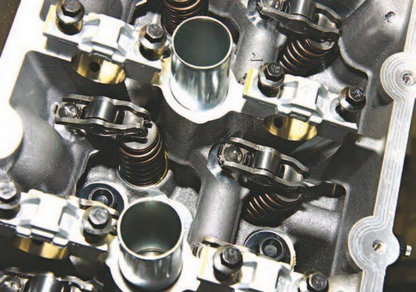 These lightweight petite roller rocker arms are a no-adjust affair. Pressurized hydraulic lash adjusters or followers maintain valve lash. Moreover, these rockers can withstand the severe punishment of a radical cam and 1,500 to 2,000 hp.