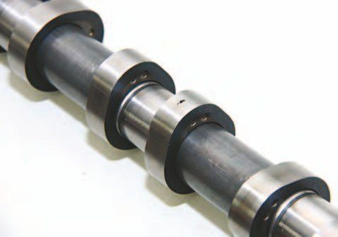 All Modular engines, including the 4.6L, 5.4L, 6.2L, and the new 5.0L, are factory fitted with composite camshafts, which are a hollow tube with individual lobes that are positioned onto the shaft as shown. Note the deep peen marks in each lobe.