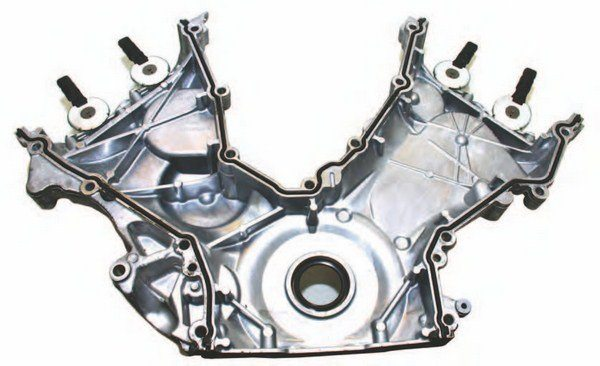 Here's the backside of the Coyote timing cover with its continuous gaskets, which provide perfect sealing. The key to effective sealing is proper installation: The seals must be firmly seated with solid contact. Lube the seals with a thin film of engine oil and ensure that they are fully seated prior to cover installation.